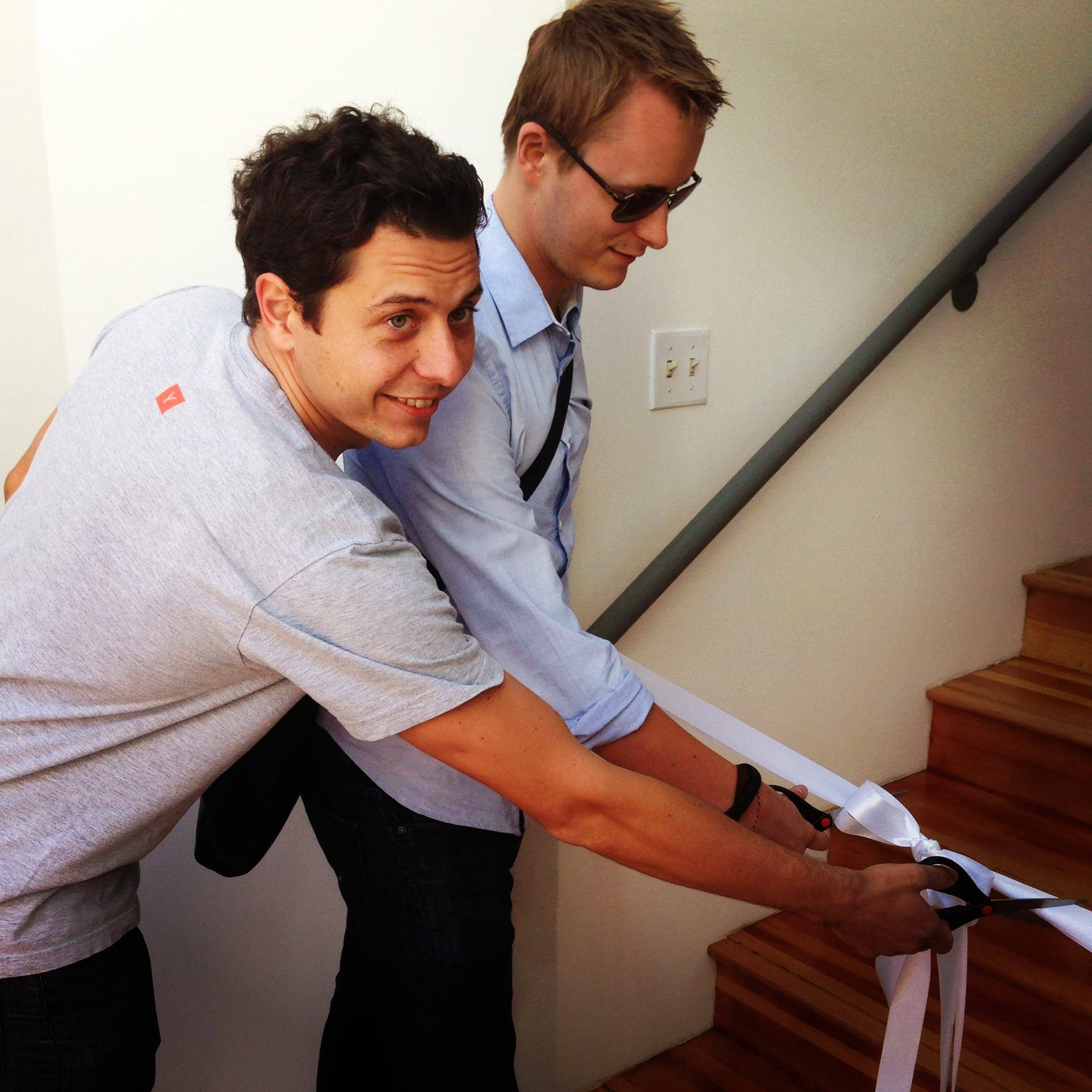 CEO Matt Mickiewicz and CTO Allan Grant cutting the ribbon to the new Hired office.